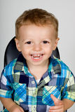 Happy Boy. Portrait of a smiling very happy young boy, toddler with plaid shirt Stock Images