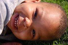Happy Boy. This little boy is so happy to be playing outside in the grass Royalty Free Stock Images
