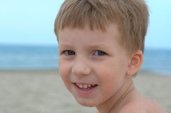 Happy boy. Happy little boy on a sand beach Royalty Free Stock Images