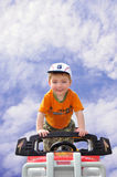 Happy boy. Cute little caucasian happy boy  playing with toy outdoors Royalty Free Stock Photo