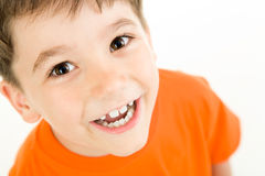 Happy boy. Portrait of happy boy laughing on a white background Royalty Free Stock Photo