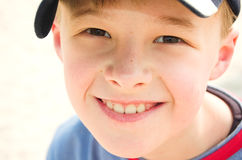 Happy boy. Young boy in cap smiling stock photo
