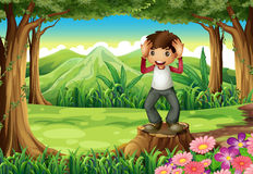 A happy boy above the stump at the forest Stock Photography