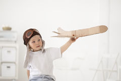 Happy boy with airplane in hand Royalty Free Stock Images