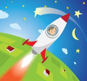 Happy boy astronaut flying on rocket into space. Astronaut boy looks out the window missiles, smiling, flying into space Royalty Free Stock Image