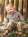 Happy boy in autumn leaves royalty free stock images