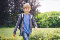 Happy boy with a backpack to go school. Education, back to school, people concept Royalty Free Stock Photo