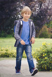 Happy boy with a backpack to go school. Education, back to school, people concept Stock Photography