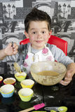Happy boy baking muffins Royalty Free Stock Photos