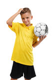 A happy boy with a ball. Active schoolboy. Young football player isolated on a white background. School soccer concept. Royalty Free Stock Images