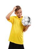 A happy boy with a ball. Active schoolboy. Young football player on a white background. School soccer concept. royalty free stock photo