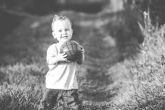 Happy boy with ball outdoors Royalty Free Stock Images