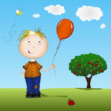 Happy boy with balloon. Happy boy holding a balloon in front of apple tree Royalty Free Stock Photos