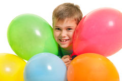 Happy boy among balloons Stock Images