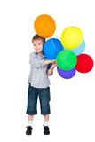 Happy boy with balloons isolated on white Stock Images
