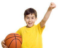 Happy boy with basketball. Young boy holding a basketball - isolated royalty free stock photos