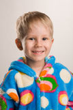 Happy boy in bathrobe Stock Images