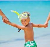 Happy boy on beach Stock Photos