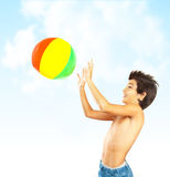 Happy boy with beach ball Stock Photo