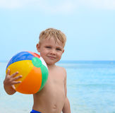 Happy boy with beach ball Royalty Free Stock Images