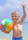 Happy boy with beach ball Stock Photo