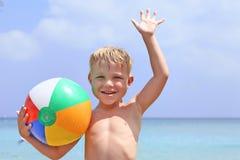 Happy boy with beach ball Stock Photography