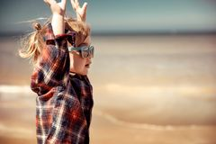 Happy boy on the beach stock photo