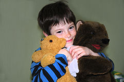 Happy boy with bears Royalty Free Stock Images