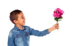 Happy boy with a beautiful bouquet of pink flowers Stock Photo