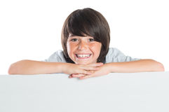 Happy boy behind board Royalty Free Stock Images