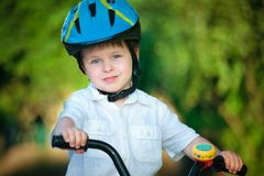 Happy boy on a bicycle Stock Images