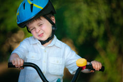 Happy boy on a bicycle Stock Photos