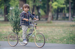 Happy boy with bicycle Royalty Free Stock Images