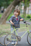 Happy boy with bicycle Stock Image