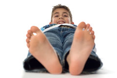 Happy boy with big feet Royalty Free Stock Photography