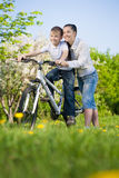Happy Boy on bike with mother Royalty Free Stock Photos