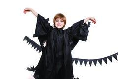 Happy boy in a black angel costume having fun Royalty Free Stock Image