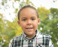Happy Boy with Black Plaid royalty free stock photography