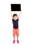 Happy boy with blackboard Stock Photos