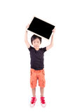Happy boy with blackboard Stock Image