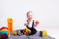 Happy boy on blanket with toys on white background Royalty Free Stock Photo