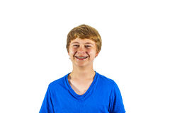 Happy boy in blue shirt laughing Royalty Free Stock Photo