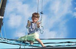 Happy boy on board of sea yacht Stock Photo