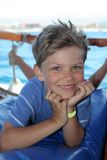 Happy boy on boat Stock Images
