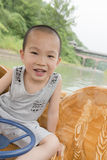 Happy boy in boat Stock Photo