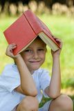Happy boy with a book Royalty Free Stock Image