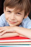 Happy boy with books. Cute little boy with books smiling and looking at camera Stock Photo