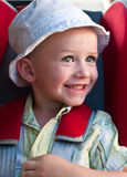 Happy boy in a booster royalty free stock photos