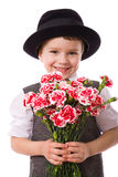 Happy boy with a bouquet of carnations Royalty Free Stock Photography