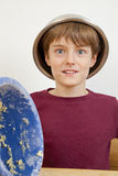 Happy boy with bowl on his head Royalty Free Stock Photo